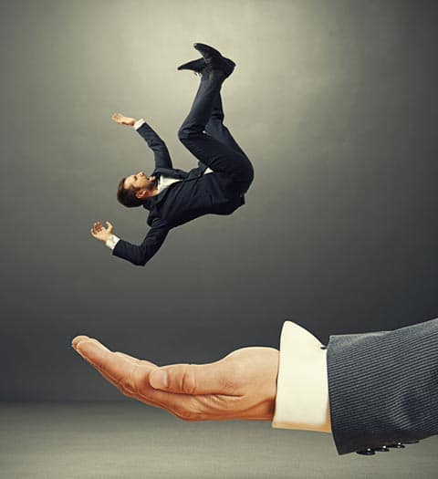 Businessman falling into the hand of a professional writer.