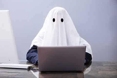The ghostwriter. A ghost at its laptop.