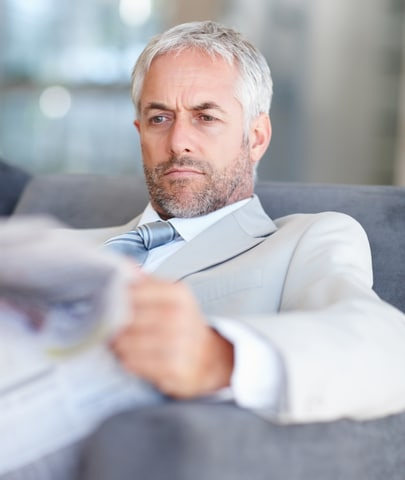 This fellow is reading about Ghostwriters Central in a high-profile business newspaper. We rock!