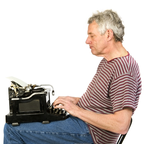 This fellow, with the 40-pound typewriter on his lap, is writing his memoirs.